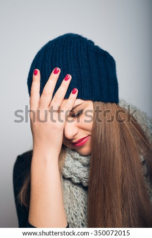 bright beautiful girl lowered her eyes and head, Christmas and New Year concept, studio photo isolated on a gray background - stock photo