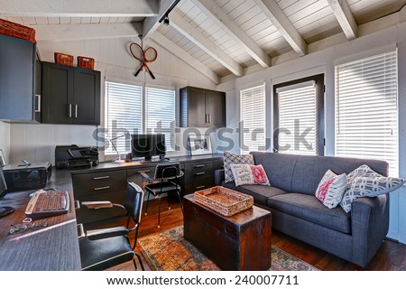 Bright beautiful home office interior design with classic American style. - stock photo