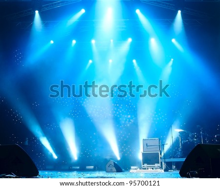 Bright beautiful rays of light on an empty stage before the concert - stock photo
