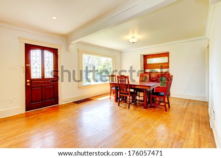 Bright big open living and dining room with hardwood floor - stock photo