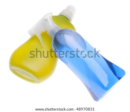 Bright blue and green bottles of cleaning liquid for spring cleaning.  Isolated on white with a clipping path.