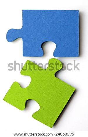 bright blue and green jig saw pieces - stock photo