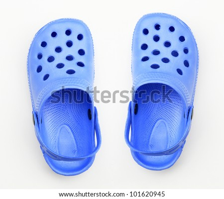 Bright blue clogs isolated on white background - stock photo
