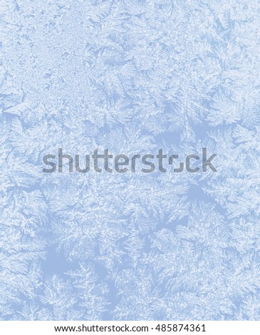 Bright blue frost pattern on a window glass,ice flowers