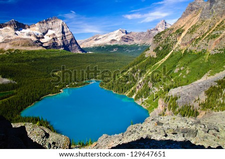 Bright Blue Lake O'Hara, Yoho National Park, Canadian Rockies - stock photo