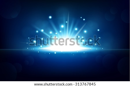 Bright blue light rising from the black horizon - stock photo