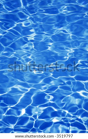 Bright blue pool water background - stock photo