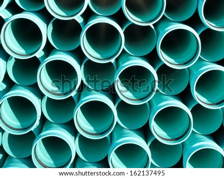Bright blue PVC pipes - stock photo