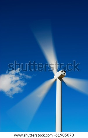 Bright blue sky moving and wind turbine - stock photo