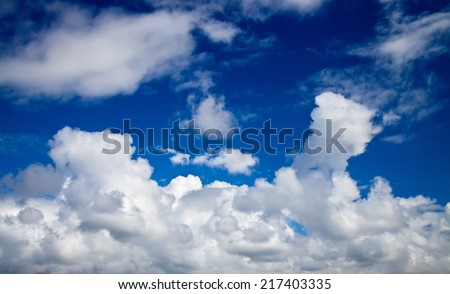 bright blue sky with clouds - stock photo