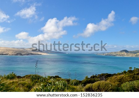 Bright Blue waters in Omapere, New Zealand - stock photo