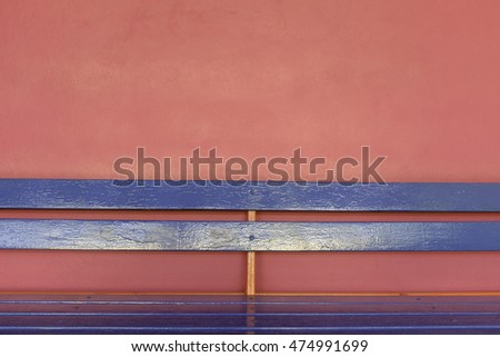 bright blue wood long bench on vivid pink color wall background