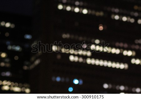 Bright Blurred City Highrise Office Building Lights At Nighttime In Chicago, Illinois  - stock photo