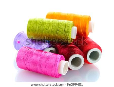 bright bobbin thread isolated on white - stock photo