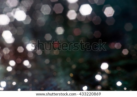 Bright bokeh hexagon shape on black background. - stock photo