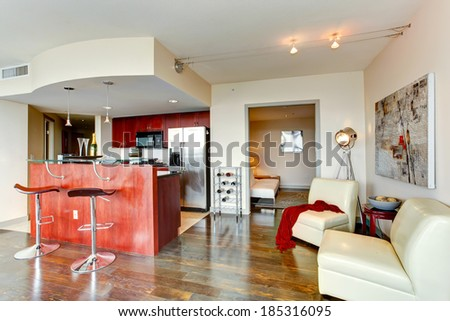 Bright burgundy kitchen room with bar and wine rack - stock photo