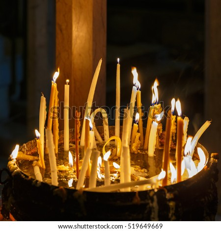 Bright candles in the Holy Sepulcher on Mount Calvary, Jerusalem, Israel