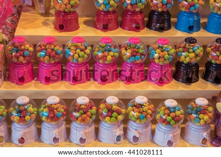 Bright candy in jars on the shelf - stock photo