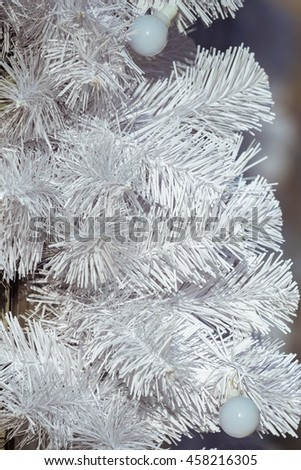 Bright Christmas background with artificial bright white spruce - stock photo