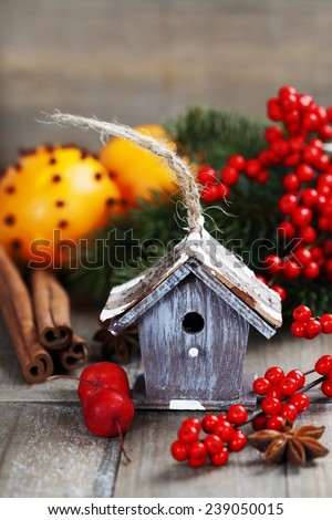 Bright christmas composition with small bird house and mulled wine - stock photo