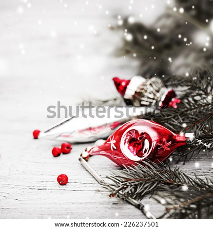 Bright christmas composition with vintage christmas decorations on wooden background - stock photo