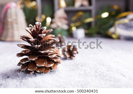 Bright christmas greeting card with pinecone and decorations. Christmas concept with copy space for text.