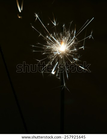 Bright christmas sparkler, bengal fire burning in the night.                        - stock photo