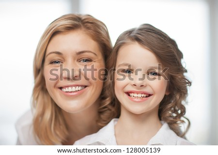 bright closeup picture of mother and daughter - stock photo
