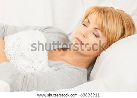 bright closeup picture of sleeping woman face - stock photo