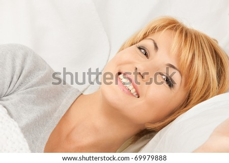 bright closeup picture of  woman in bed - stock photo