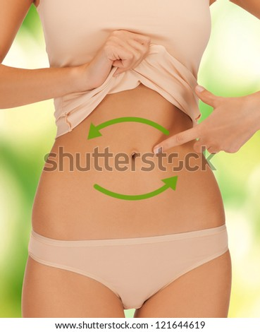 bright closeup picture of woman showing belly - stock photo