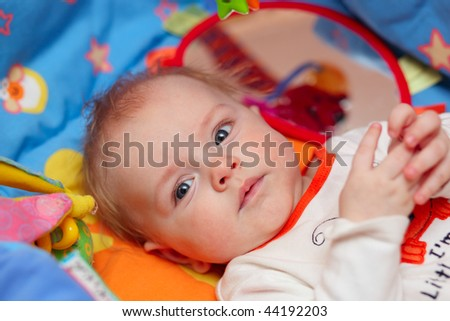 Bright closeup portrait of adorable baby - stock photo