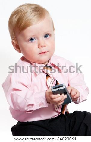 bright closeup portrait of adorable baby businessman - stock photo