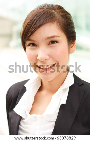 Bright closeup portrait of asian business woman