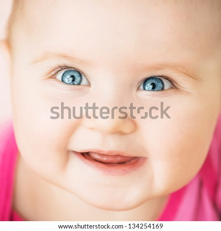 bright closeup portrait of smiling baby - stock photo