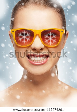 bright closeup portrait picture of funny teenage girl in shades - stock photo