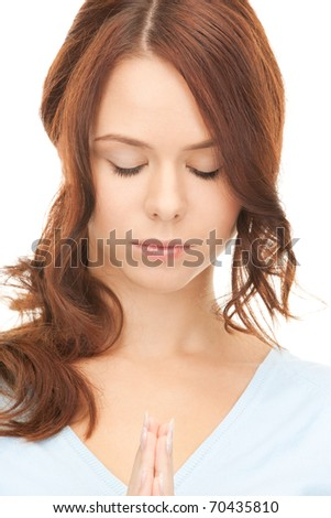 bright closeup portrait picture of praying businesswoman - stock photo
