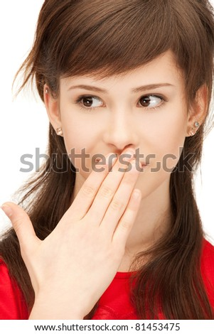 bright closeup portrait picture of teenage girl with palms over mouth - stock photo