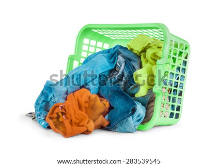 Bright clothes in a laundry basket on white background - stock photo