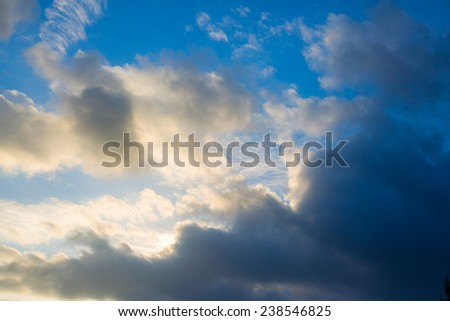 Bright clouds in the dark blue sky - stock photo