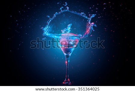 Bright cocktail with lemon in glass and splashing water on dark background - stock photo