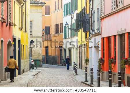 Bright color beautiful street with residential houses in Parma, Emilia Romagna province, Italy. - stock photo