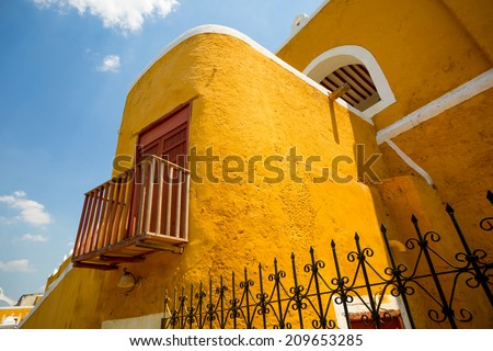 bright color colonial Spanish building closeup details in the Mexican town of Izamal - stock photo