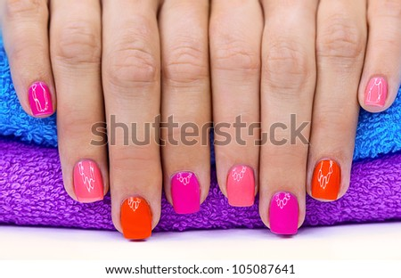 Bright color manicure on a bright background - stock photo