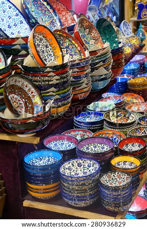 Bright colored enamel bowls for sale in the Grand Bazaar (Kapali carsi ) in Istanbul, Turkey - stock photo