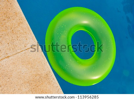 Bright colored floater in a swimming pool - stock photo