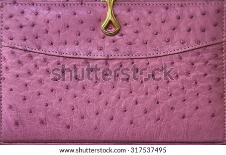 bright colored leather. detail of a handbag made out of ostrich leather. - stock photo