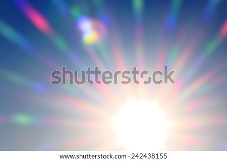 bright colored rays of  sun shining in sunset - stock photo