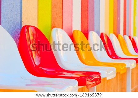 bright colored seats in the kids' club - stock photo