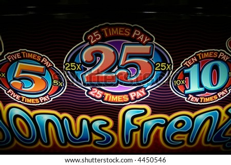 bright colored signs and symbols on a slot machine - stock photo